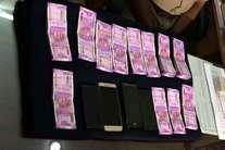देखें तस्वीरें: हैदराबाद में पकड़े गए 12 लाख के नए नोट