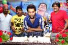 Ram Pothineni cutting his birthday cake.