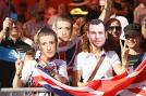 British fans celebrate after the twentieth and final stage of the 2012 Tour de France in Paris. (Getty Images)