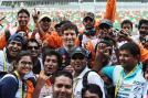 Mark Webber of Australia with the race marshalls during previews for the Indian Formula One Grand Prix at Buddh International Circuit.