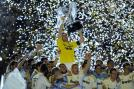 Jose Mourinho struck in his second year as Real Madrid coach to land the La Liga trophy. Here Iker Casillas lifting the silverware with team-mates after the match against Mallorca on May 13.