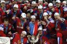Ecstatic Russian ice hockey team with their gold medals and trophy after beating Slovakia in the IIHF men's ice hockey World Championship final in Helsinki May 20.