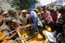 Demonstrators try to cross a police barricade during a protest outside police headquarters in New Delhi April 20, 2013.