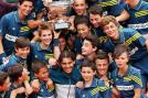Rafael Nadal poses with the ballboys and ballgirls after his victory. (Getty Images)