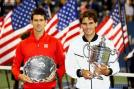 Winner Rafael Nadal poses with the US Open 2013 trophy while Novak Djokovic stands with his runner-up trophy. (Getty Images)