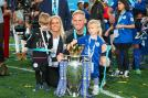 Kasper Schmeichel and girlfriend Stine Gyldenbrand celebrate with the Premier League trophy. (Photo Credit: Getty Images)