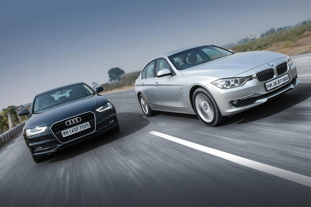 Luxury car shootout 2012 bmw 3 series versus audi a4 news18