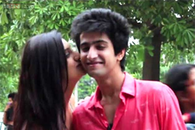 Two indian girls kissing