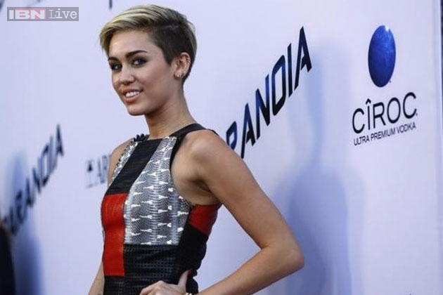 Miley Cyrus goes topless at a beach in Hawaii - News18