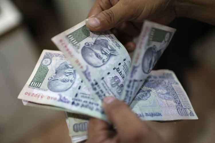 Rupee opens higher by 12 paise 64.01 per dollar