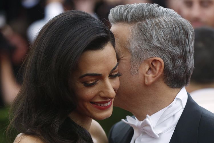 Amal Clooney has the hugest sense of humour with the way she dresses, says designer
