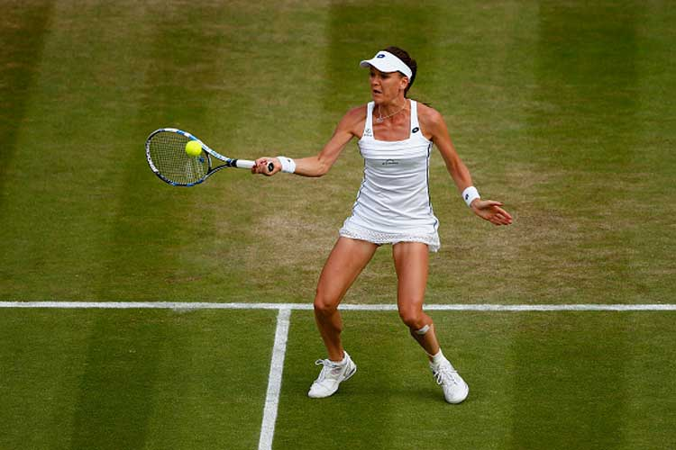 Radwanska's grasscourt pedigree helps her reach Wimbledon semis
