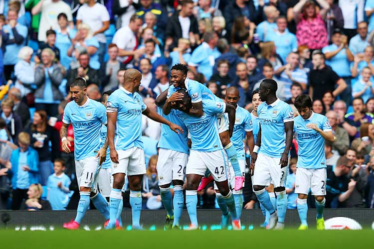 Manchester City flex muscles as English clubs break spending record