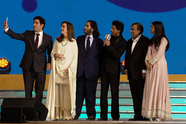 The Ambani family with Shah Rukh Khan at the Reliance Jio employee launch event.