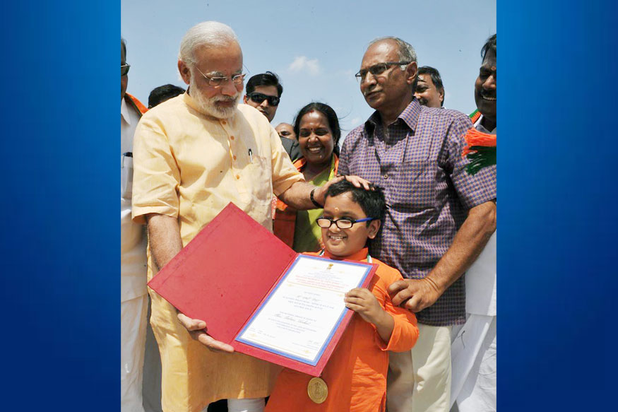 PM Modi Meets Child Prodigy at Airport, Tweets Pic With Him