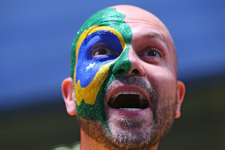 A Brazilian fan gestures during the Opening Ceremony of the Rio 2016 Olympic. (Photo Credit: Reuters)