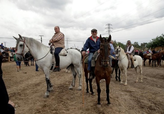 Revellers on horses wait for the start of the Toro de la Pena, formerly known as Toro de la Vega festival, in Tordesillas, Spain