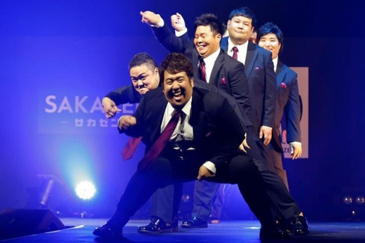 Models dance on the runway during Tokyo Pocchari collection, Japan's first fashion show for plump men in Tokyo