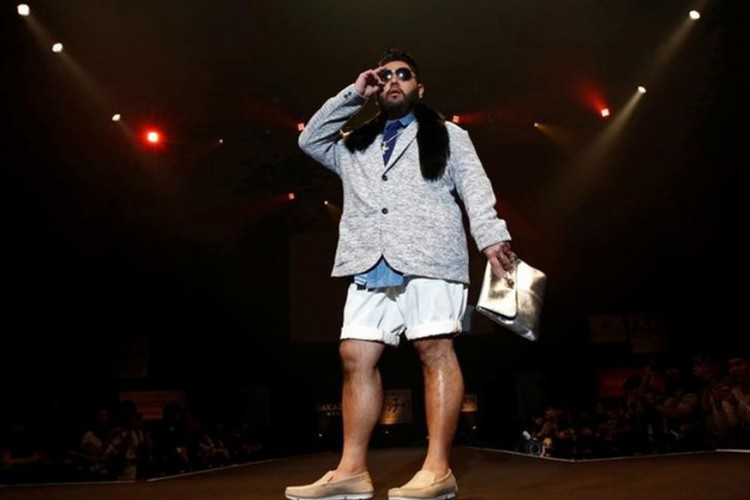 A model poses on the runway during Tokyo Pocchari collection, Japan's first fashion show for the plump men in Tokyo
