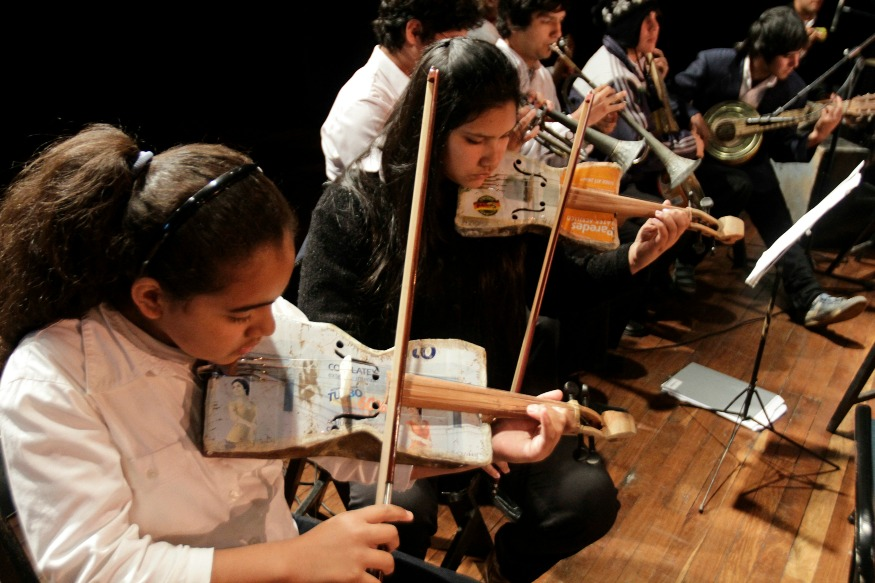 (Photo: Reuters/Music students play their instruments made from recycled objects during a concert of the Orchestra of Recycled Instruments of Cateura.)