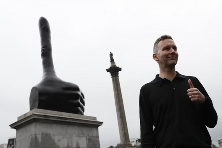 "Artist David Shrigley poses after the unveiling of his artwork ""Really Good"" on the fourth plinth at Trafalgar Square in central London"
