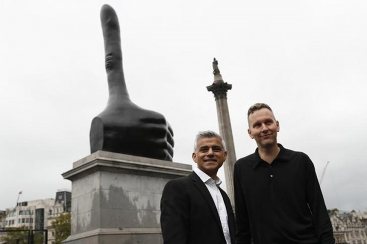 "London Mayor Sadiq Khan poses with artist David Shrigley after the unveiling of his artwork ""Really Good"" on the fourth plinth at Trafalgar Square in central London"