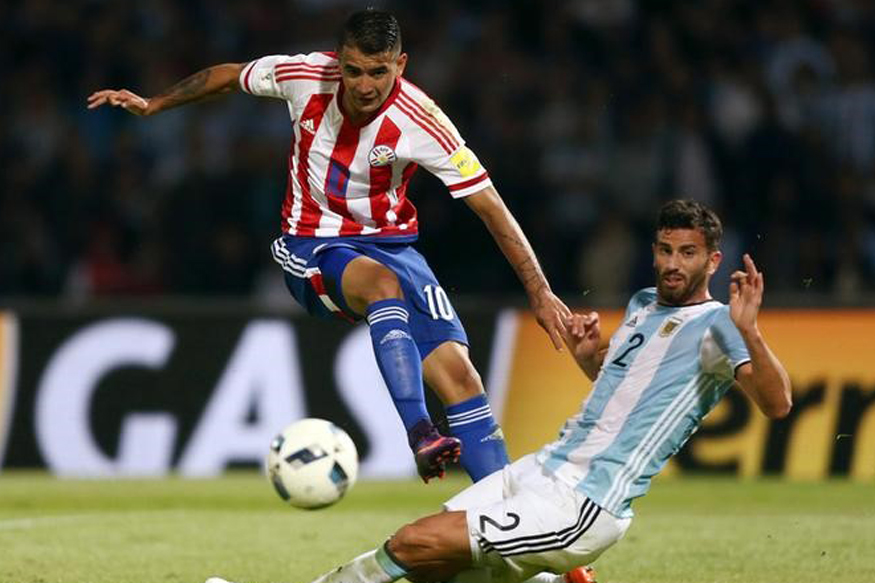 Argentina and Paraguay playes in action during a FIFA World Cup qualifier. (Reuters)