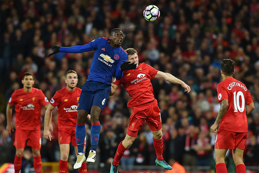 James Milner of Liverpool competes with Paul Pogba Manchester United. (Getty Images)