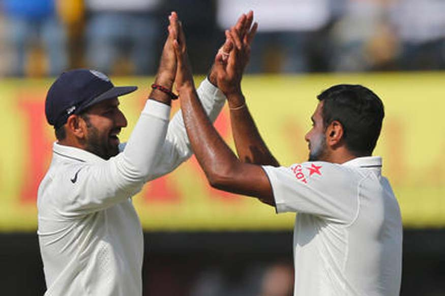 R Ashwin celebrates with Cheteshwar Pujara after demolishing New Zealand batting with his Six 10-wicket haul. (Picture Credit: Getty Images)