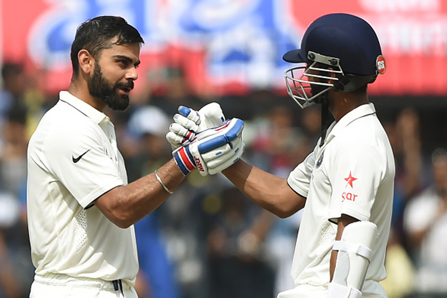 Ajinkya Rahane congratulates skipper Virat Kohli after his double Ton on the second day of the third Test match between India and New Zealand at The Holkar Cricket Stadium in Indore on October 9, 2016. (Picture Credit: Getty Images)