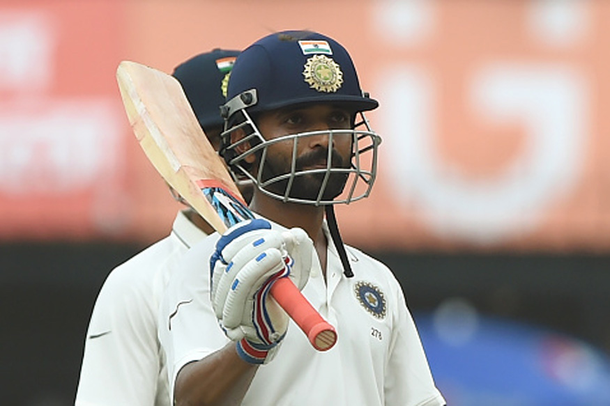 Indian batsman Ajinkya Rahane raises his bat after his century on the second day of the third Test match between India and New Zealand at The Holkar Cricket Stadium in Indore on October 9, 2016. (Picture Credit: Getty Images)