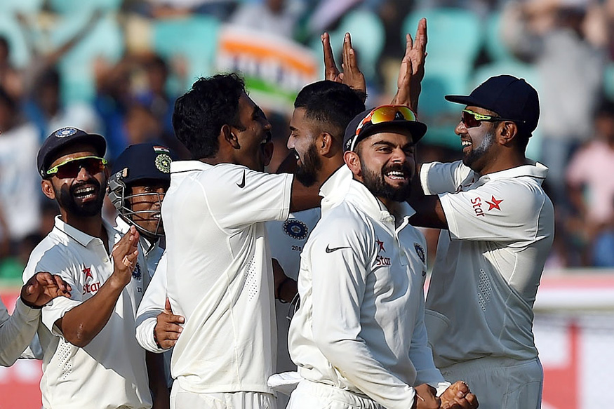 Indian players celebrate after beating England in the second Test match at Visakhapatnam (Photo Courtesy: AFP)