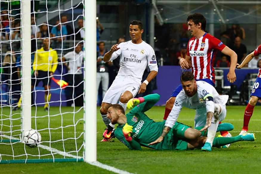 Ronaldo hat trick downs Atletico, extends Real lead