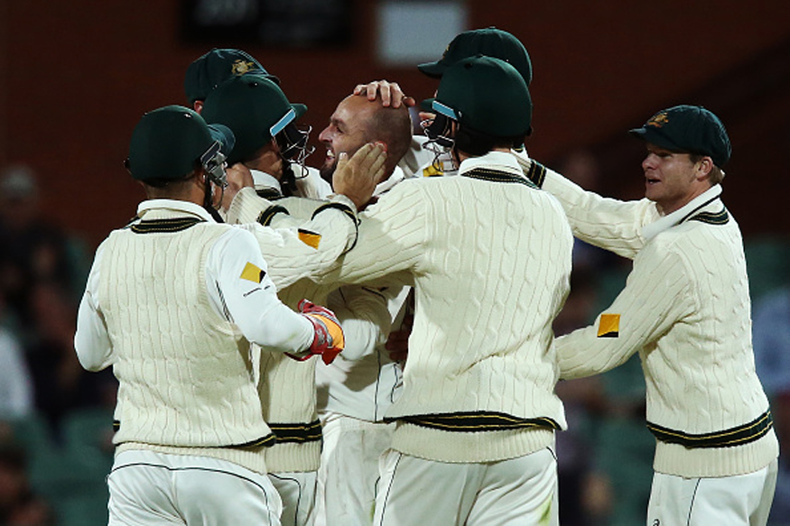 Nathan Lyon and other Australia player celebrating the fall of a wicket. (Getty Images)