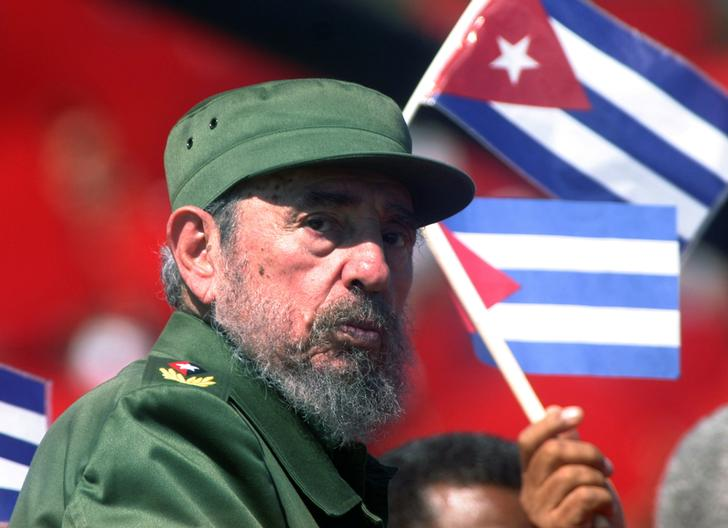 File photo of then Cuban President Fidel Castro glancing over his shoulder during the May Day commemoration at Revolution Square in Havana