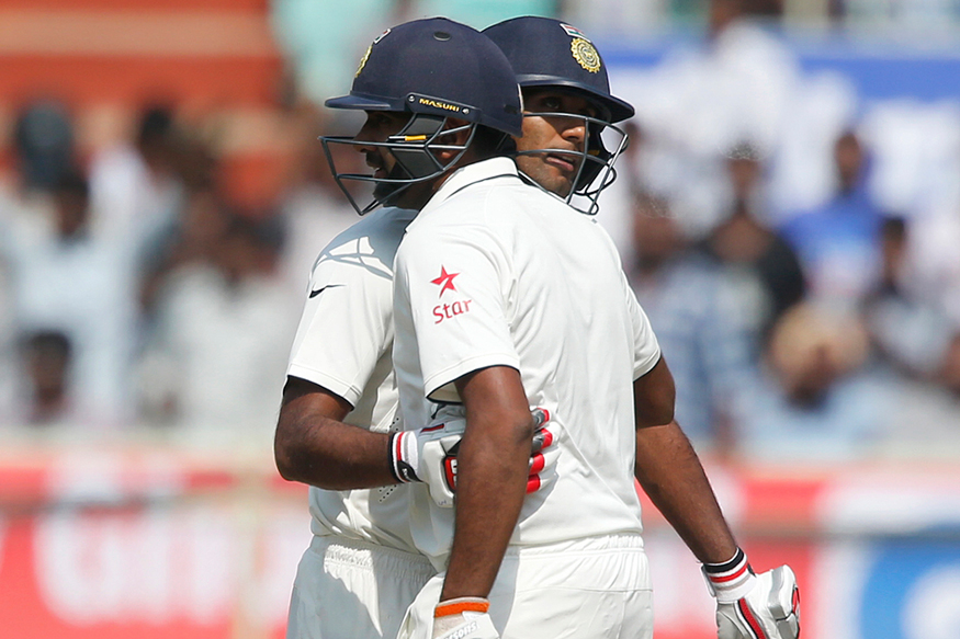 Jayant Yadav, left, hugs R Ashwin to congratulate on scoring fifty runs on the second day of their second cricket Test match against England in Visakhapatnam. (AP)