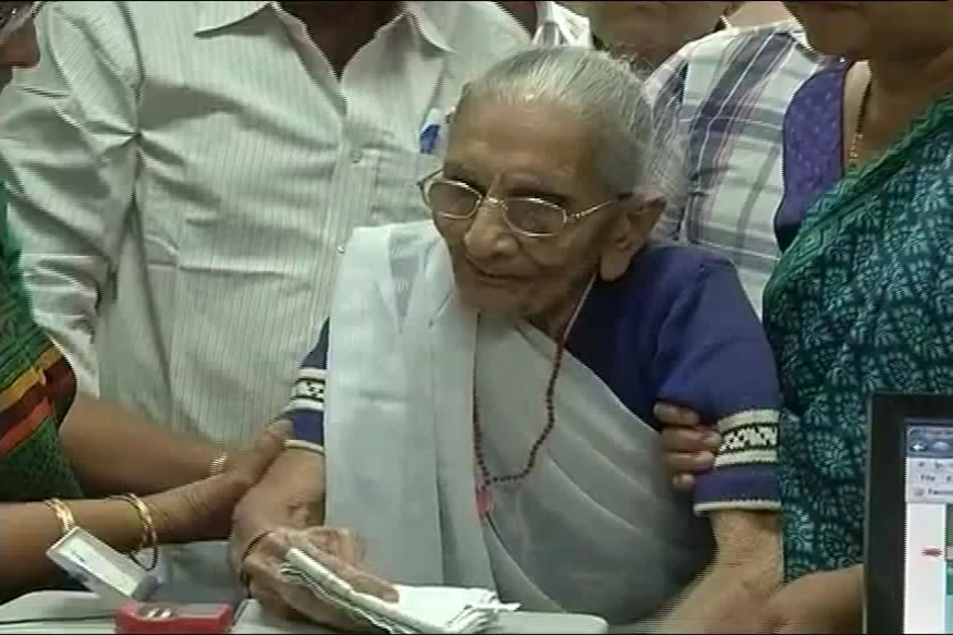 Prime Minister Narendra Modi's mother exchanges old notes in Gandhinagar