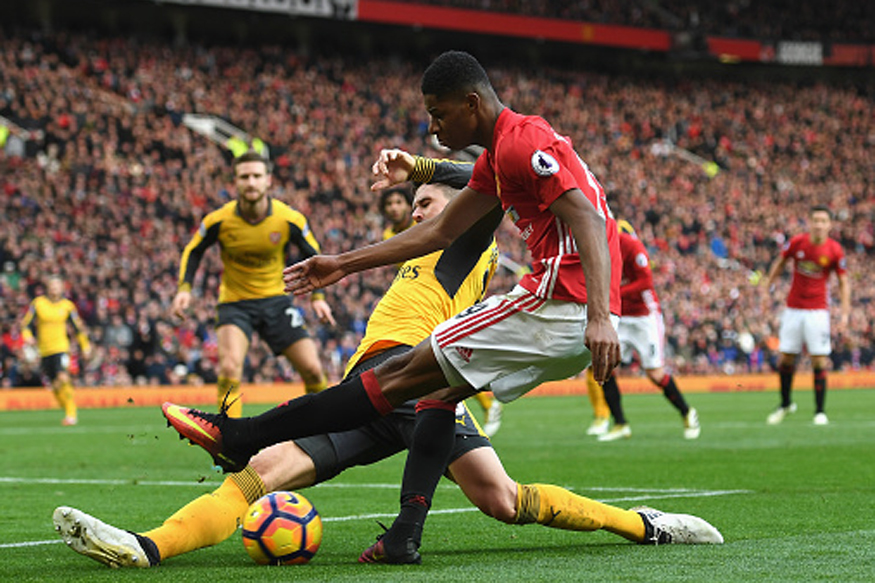 Arsenal and Manchester United players in action during their Premier League clash at Old Traford. (Getty Images)
