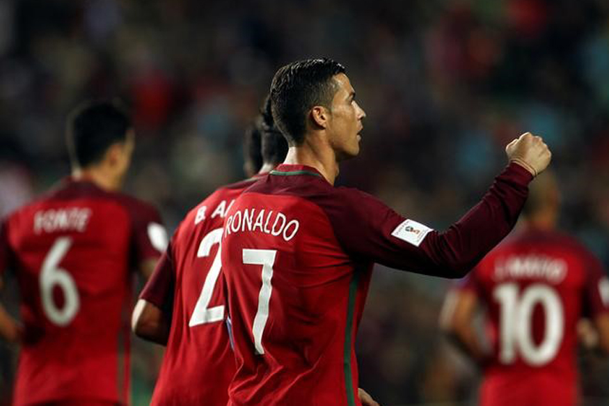 Cristiano Ronaldo and other Portugal players celebrating a goal against Latvia. (Reuters)