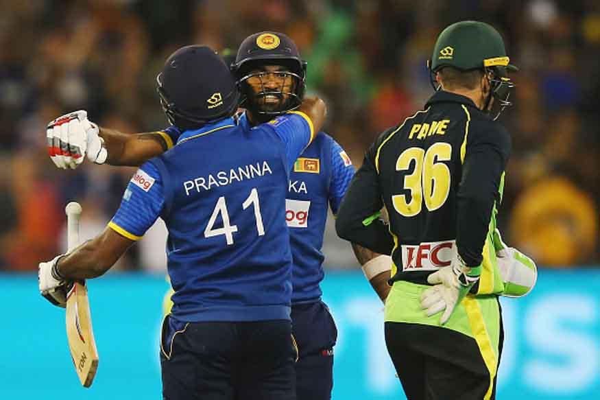 Seekkuge Prasanna of Sri Lanka hugs Chamara Kapugedera after he hit the winning runs during the first International Twenty20 match between Australia and Sri Lanka at Melbourne Cricket Ground. (Getty Images)