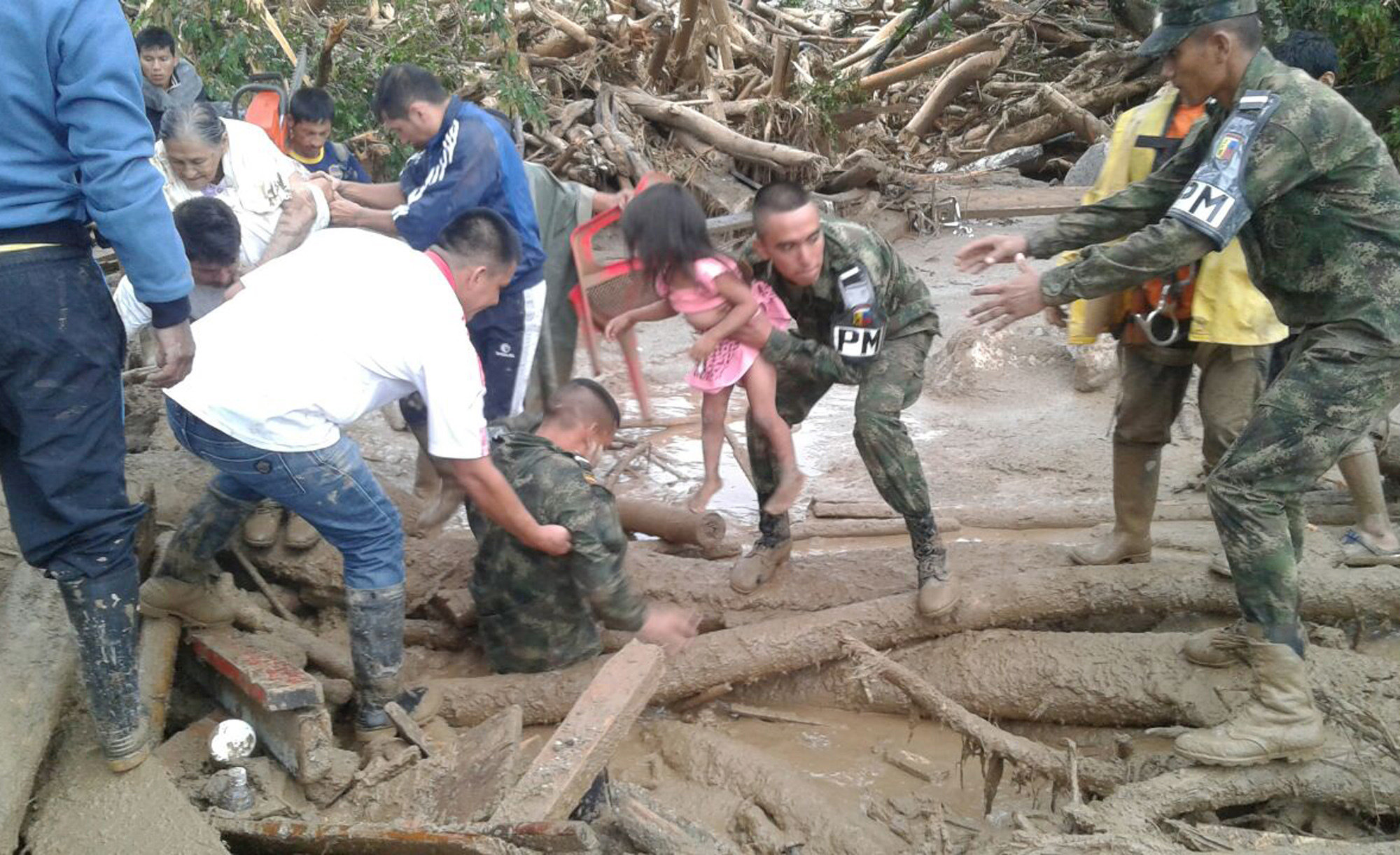 In this handout photo released by the Colombian National Army, soldiers and residents work together in rescue efforts in Mocoa, Colombia on April 1, 2017. (Colombian Army Photo via AP)