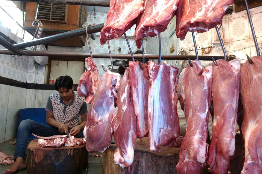 Mohammed Dilawar at work in his buffalo meat shop at Nizamuddin Basti.