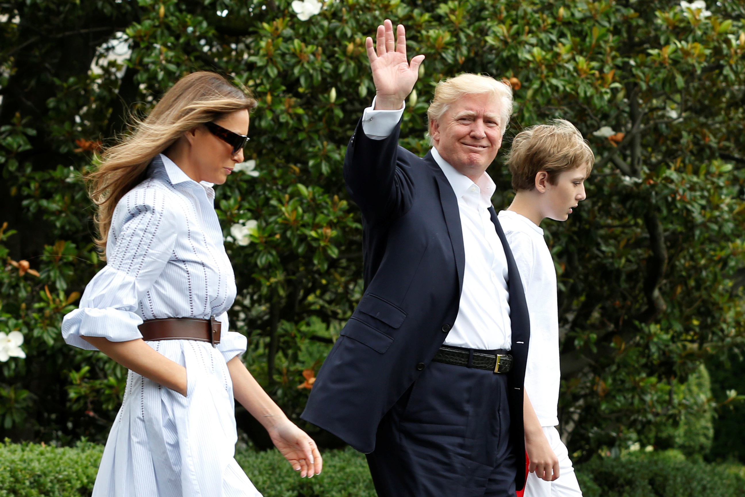 US President Trump with first lady Melania and their son Barron walk out from the White House in Washington