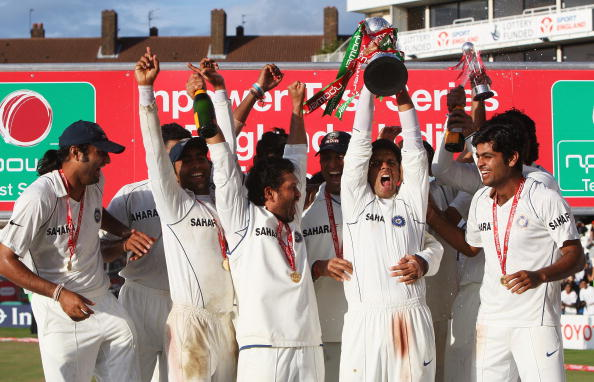 Rahul Dravid of India holds the npower trophy as Indian players celebrate their series win against England. (Getty Images)