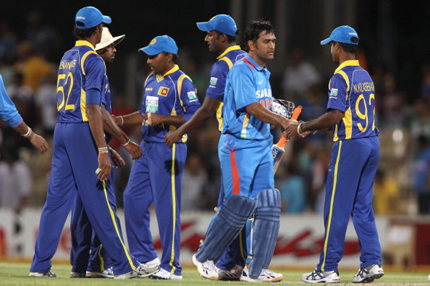 File image of former India skipper MS Dhoni shaking hands with Sri Lankan cricketer. (Getty Images)