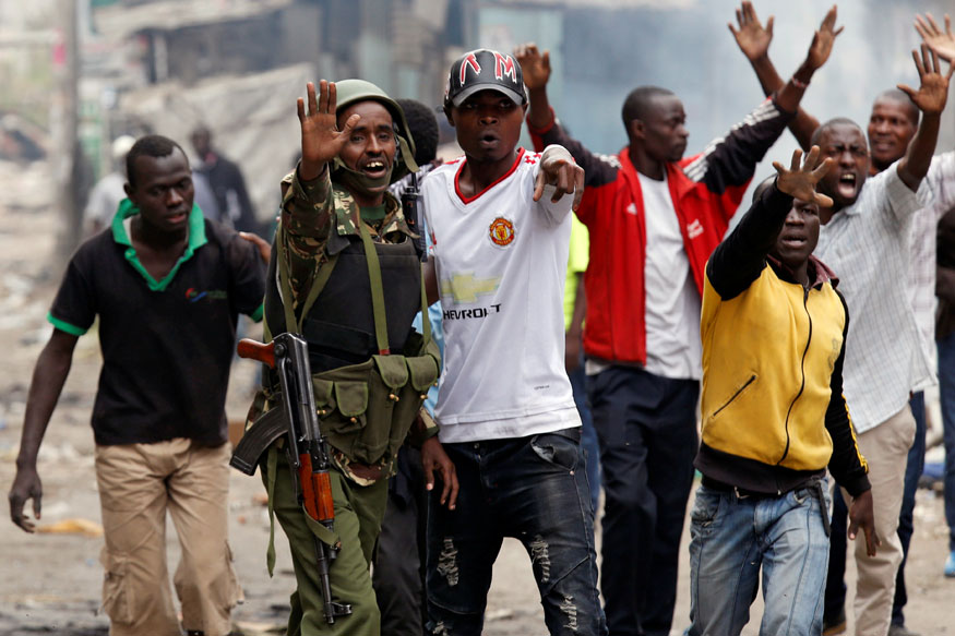 Protesters supporting opposition leader Raila Odinga attempt to make peace with policemen in Mathare, in Nairobi (REUTERS)