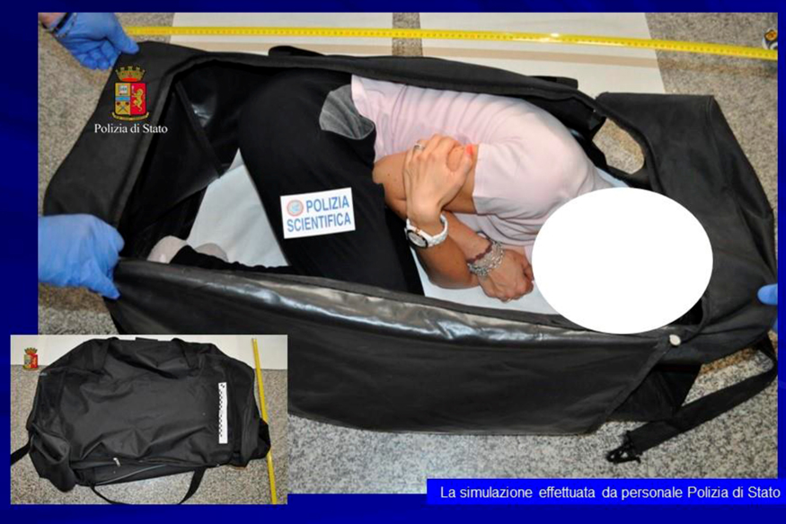 Italian police handout shows a person taking part in a reenactment by Italian police on how a kidnapped British model was kept in a bag