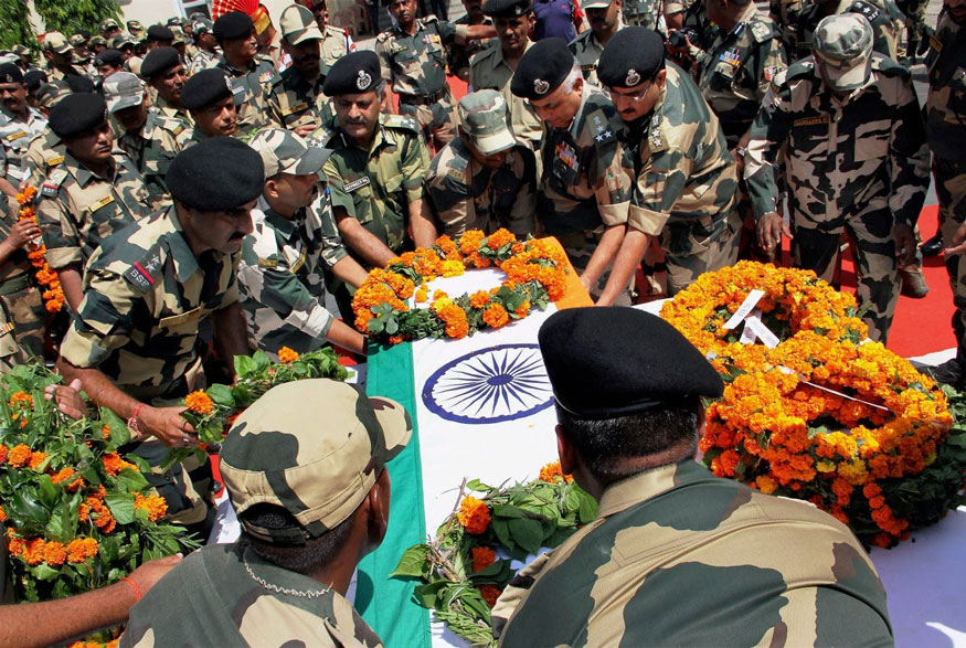 Jammu: BSF officers carry the coffin of Constable Brijendra Bahadur Singh who was martyred in the firing from the Pakistan side of the border, during a wreath-laying ceremony in Jammu on Friday. (Image: PTI)