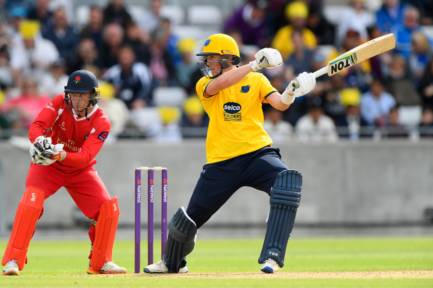 Adam Hose hits out as Jos Buttler looks on during the  Natwest T20 Blast match between Birmingham Bears and Lancashire Lightning.  (Photo by Stu Forster/Getty Images)