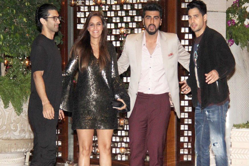 (Photo: Aditya Roy Kapur, Neha Dhupia, Arjun Kapoor and Siddharth Malhotra at the Ambani bash/ Yogen Shah)